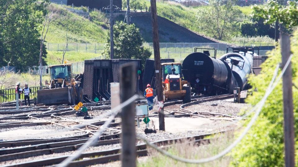CP rail cars sit crumpled on a track near the Bonnybrook train bridge that runs south of the CP Ogden rail yard in Calgary, Alberta on June 27, 2013.  (Jordan Verlage /  THE CANADIAN PRESS)