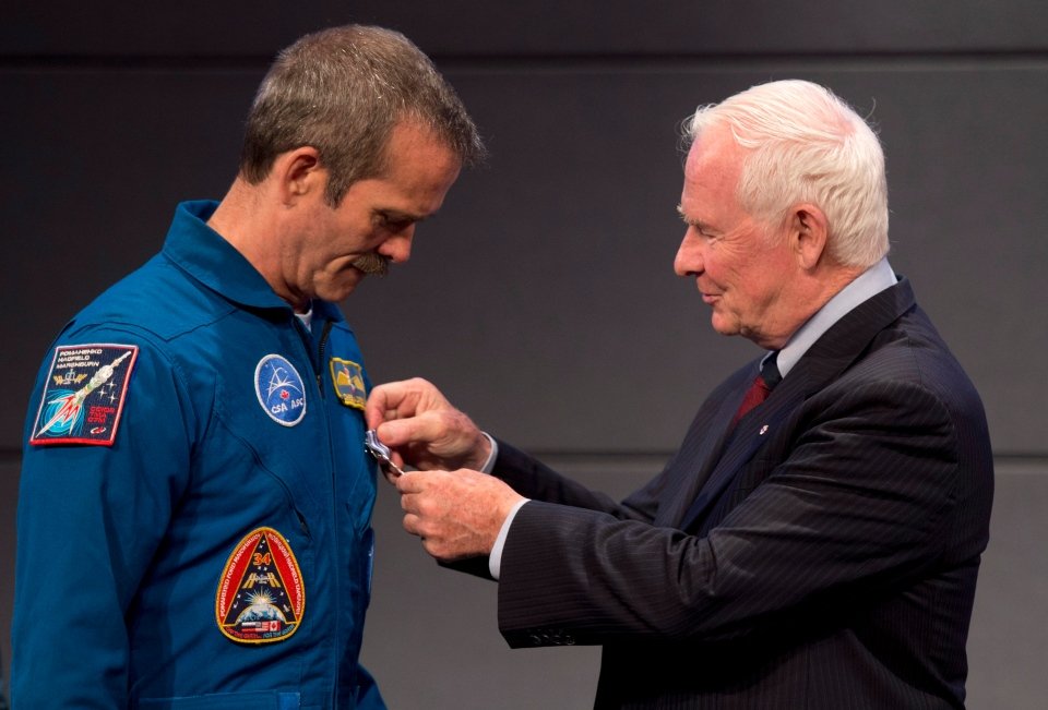 Canadian astronaut Chris Hadfield receives the Meritorious Service Cross from Governor General David Johnston on June 27, 2013 in St-Hubert, Que. (Paul Chiasson/THE CANADIAN PRESS)