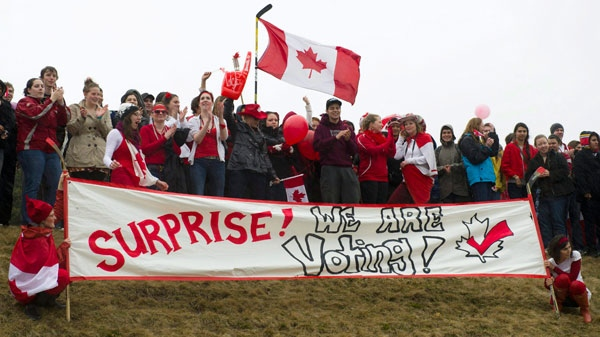 Students from the University of Guelph hold a rally to show support for the student vote as Prime Minister Stephen Harper arrives to a campaign event in Guelph Ont., on Monday, April 4, 2011. (Sean Kilpatrick / THE CANADIAN PRESS)