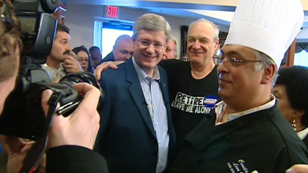 Stephen Harper gets pictures taken with supporters at a campaign stop in Thornhill, Ont., Friday, April 15, 2011.