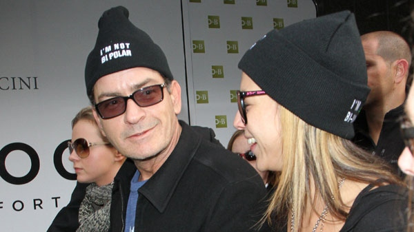 Charlie Sheen is seen walking from the Ritz-Carlton hotel to Massey Hall in support of bipolar disorder awareness, Toronto, Friday, April 15, 2011.