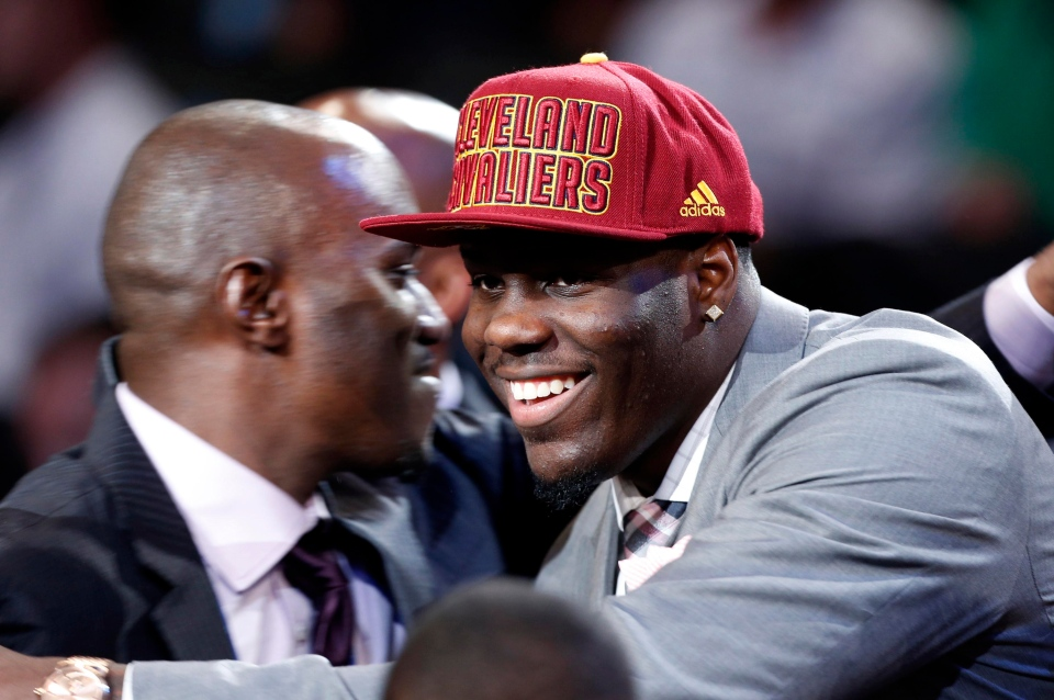 UNLV's Anthony Bennett smiles after being selected first overall by the Cleveland Cavaliers in the NBA basketball draft on Thursday, June 27, 2013, in New York. (AP Photo/Jason DeCrow)