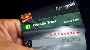 Cards from CIBC, TD Bank and Aeroplan as shown in Montreal Thursday, June 27, 2013. (Ryan Remiorz / THE CANADIAN PRESS)