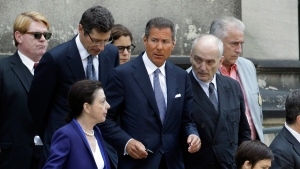 "HBO CEO Richard Plepler, center, and David Chase, center right, producer of ""The Sopranos"", walk out of Cathedral Church of Saint John the Divine after funeral services for actor James Gandolfini, Thursday, June 27, 2013, in New York. (AP / Julio Cortez)"
