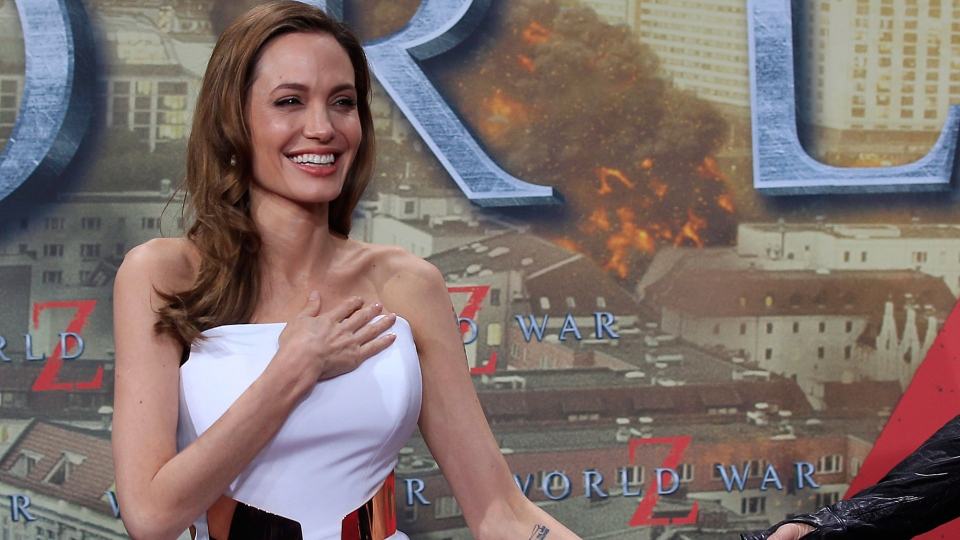 Angelina Jolie arrives with Brad Pitt, unseen, for the film premiere World War Z in Berlin, Germany, Tuesday, June 4, 2013 . (AP / Frank Augstein)