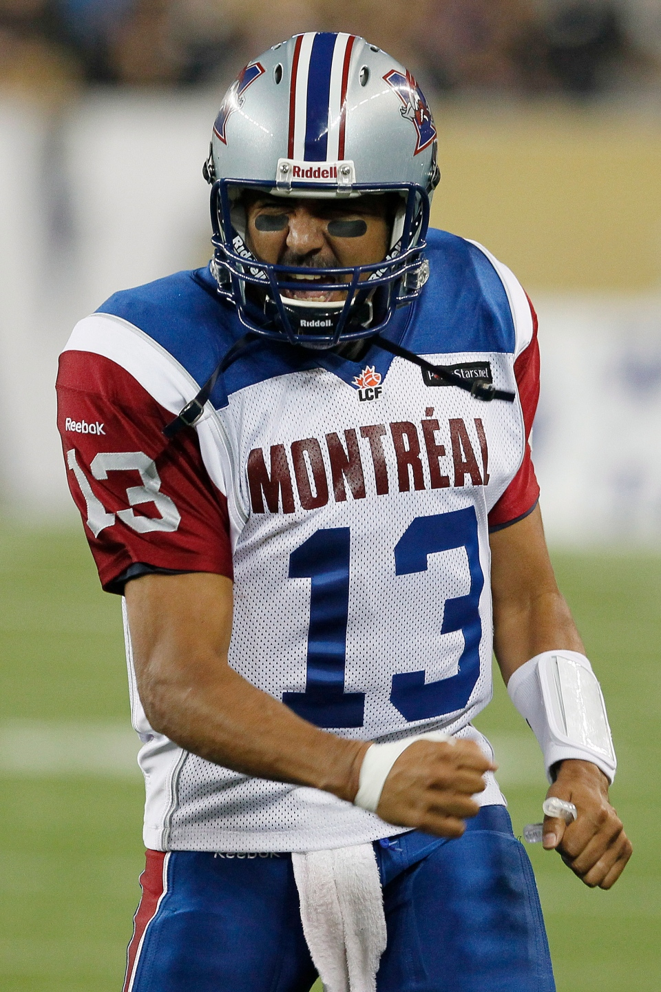 Montreal Alouettes quarterback Anthony Calvillo (13) celebrates a touchdown against the Winnipeg Blue Bombers during the second half of their CFL game at Investors Group Field in Winnipeg Thursday, June 27, 2013. THE CANADIAN PRESS/John Woods