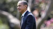 U.S. President Barack Obama walks across the South Lawn of the White House toward Marine One in Washington, as he travels to Pennsylvania, Wednesday, April 6, 2011. (AP / Carolyn Kaster)