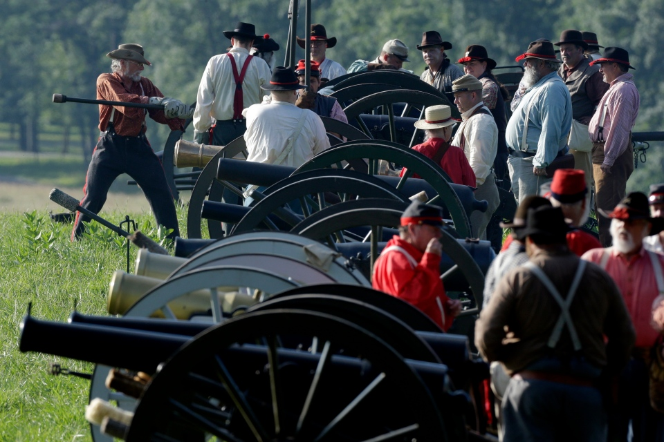 Confederate re-enactors prepare for a demonstration of a battle during ongoing activities commemorating the 150th anniversary of the Battle of Gettysburg, at Bushey Farm in Gettysburg, Pa.. Friday, June 28, 2013. (AP / Matt Rourke)
