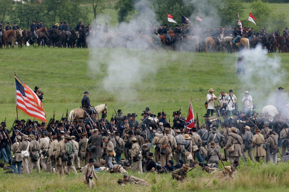 Re-enactors demonstrate a battle during ongoing activities commemorating the 150th anniversary of the Battle of Gettysburg, at Bushey Farm in Gettysburg, Pa., Friday, June 28, 2013. (AP / Matt Rourke)