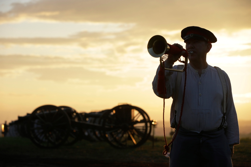 George Proulx of Cumberland, R.I., plays reveille during ongoing activities commemorating the 150th anniversary of the Battle of Gettysburg, Friday, June 28, 2013. (AP / Matt Rourke)