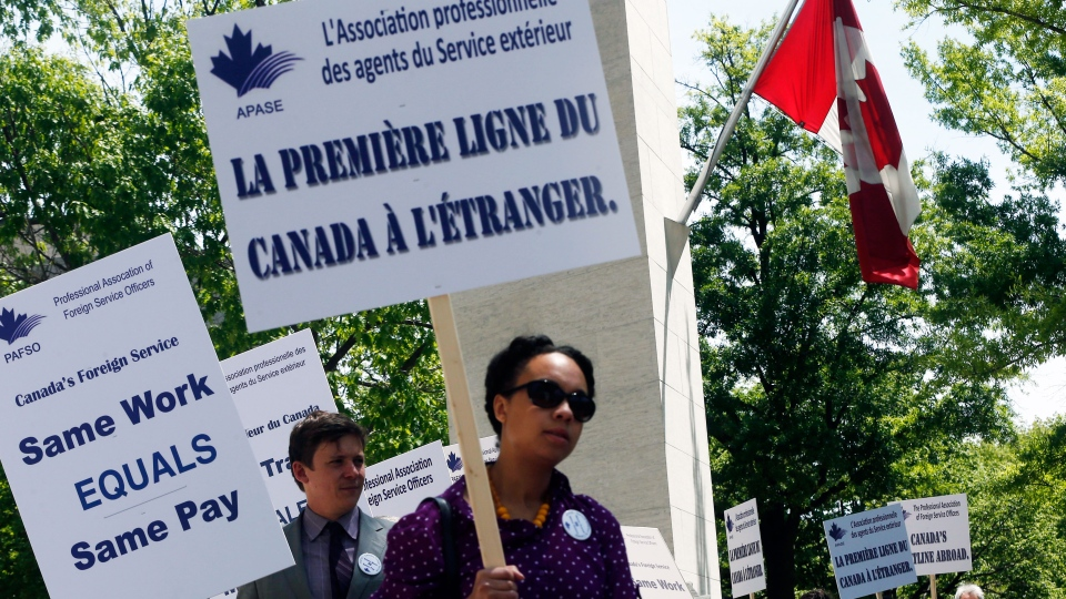 Canadian foreign service officers protest in front of the Canadian Embassy in Washington, Friday, May 3, 2013. (AP / Charles Dharapak)