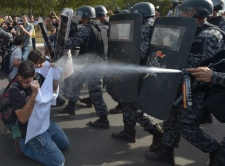 Policeman sprays pepper gas in Brasilia
