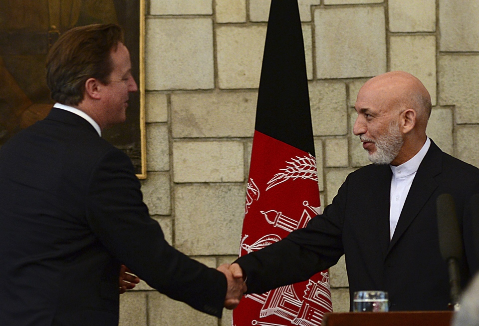 Afghan President Hamid Karzai, right, shakes hands with British Prime Minister David Cameron during a press conference at the presidential palace in Kabul, Afghanistan, Saturday, June 29, 2013. (AP / Massoud Hossaini)