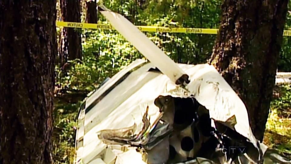 Debris from a collision between a small plane and a glider is scattered among the trees in Nairn Falls provincial campground, near Pemberton, B.C., on June 29, 2013. (CTV)
