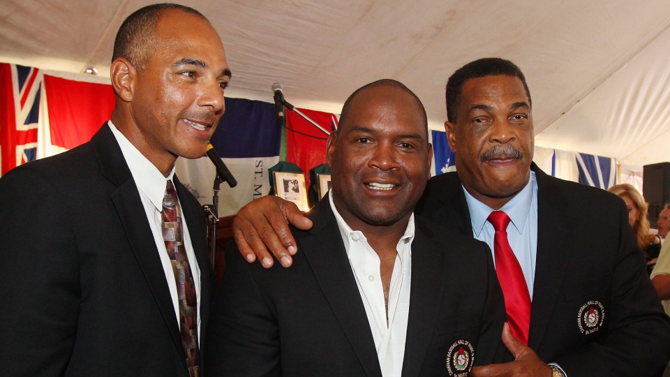 From left, Rob Ducey, Tim Raines and George Bell congratulate each other in their Hall of Fame jackets at the induction ceremony for the Canadian Baseball Hall of Fame in St. Mary's, Ont., Saturday June 29, 2013. (Dave Chidley / THE CANADIAN PRESS)