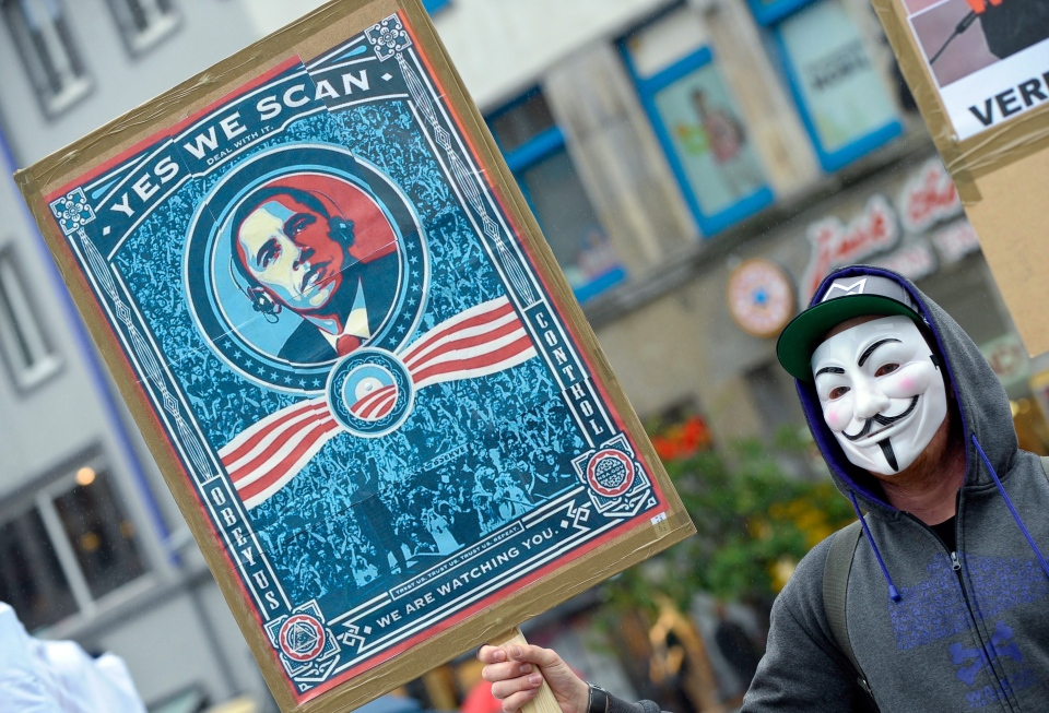 A demonstrator protests with a poster against NSA in Hanover, Germany, on Saturday June 29, 2013. (AP / Peter Steffen)