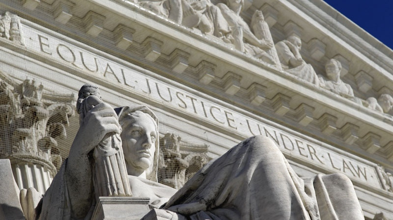 A detail of the West Facade of the U.S. Supreme Court is seen in Washington, Monday, March 7, 2011. (AP Photo/J. Scott Applewhite, File)