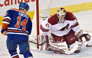 Phoenix Coyotes goalie Mike Smith makes the save on Edmonton Oilers' Jordan Eberle during first period NHL hockey action in Edmonton, Alta., on Wednesday April 10, 2013. (Jason Franson / THE CANADIAN PRESS)