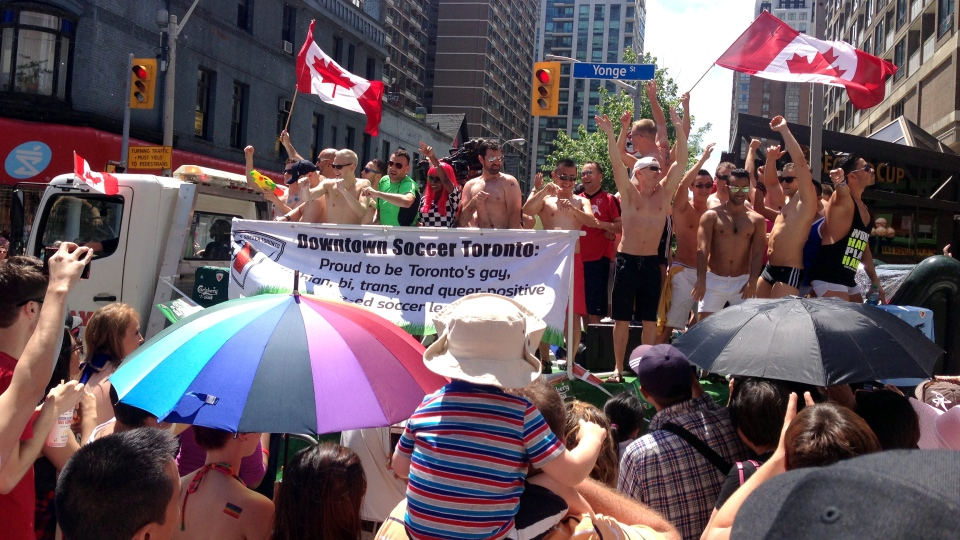 Crowds gather to watch the 33rd annual Pride parade in Toronto, Sunday, June 30, 2013. (Ashley Rowe / CTV Toronto)