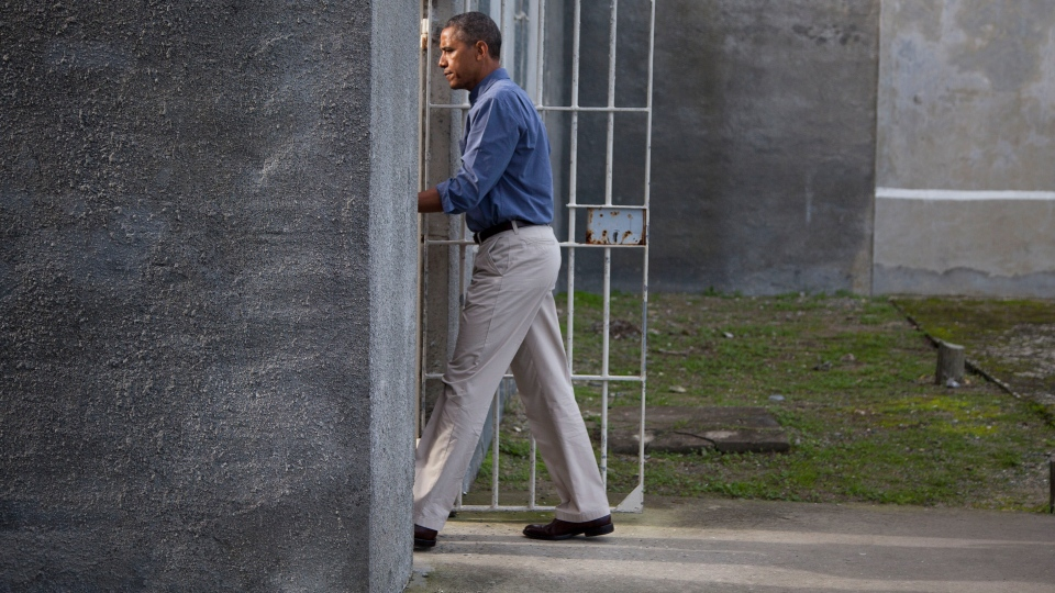 U.S. President Barack Obama walks into a cell block during a tour of Robben Island on Sunday, June 30, 2013, in Robben Island, South Africa. (AP / Evan Vucci)