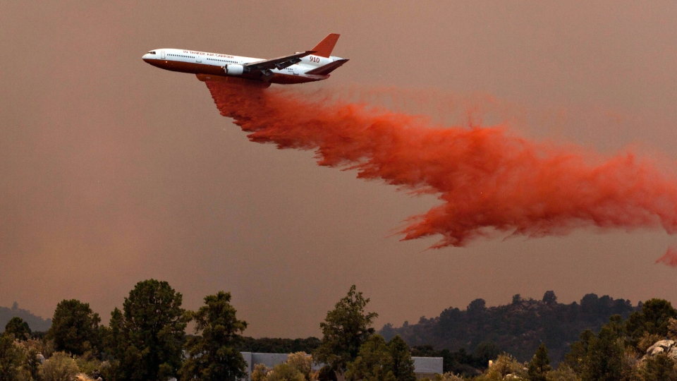 Tanker 910 makes a retardant drop Yarnell Hill Fire to help protect the Double Bar A Ranch near Peeples Valley, Ariz., Sunday, June 30, 2013. (The Arizona Republic, Tom Story)