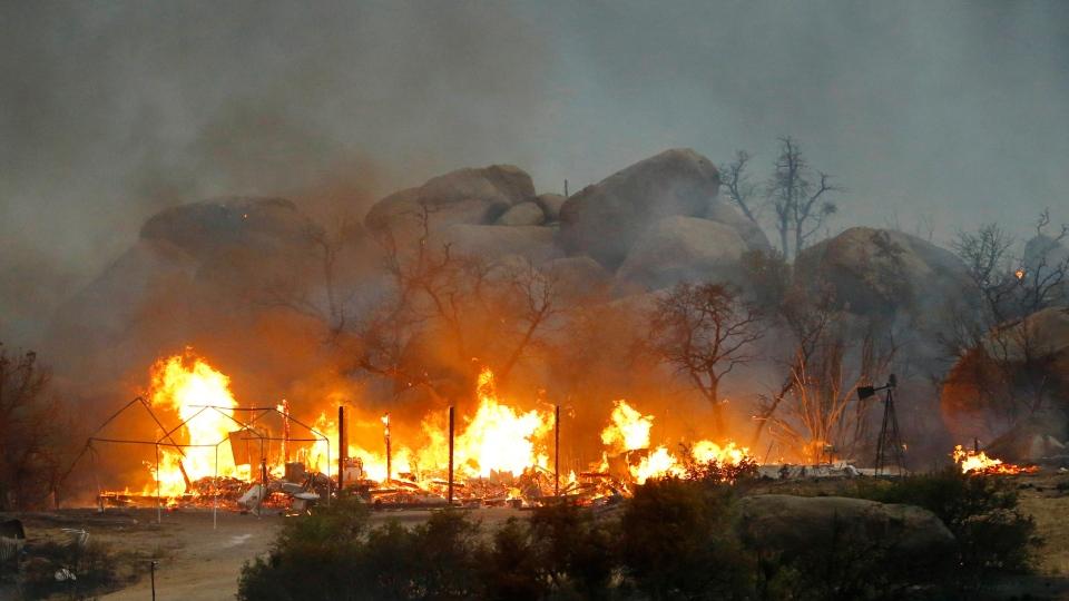 Homes burn as the Yarnell Hill Fire burns in Glenn Ilah, near Yarnell, Ariz., on Sunday, June 30, 2013. (The Arizona Republic, David Kadlubowski)