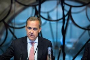 Mark Carney, the new Governor of the Bank of England, attends a monetary policy committee (MPC) briefing on his first day on the job inside the central bank's headquarters in London Monday July 1, 2013. (AP / Jason Alden)