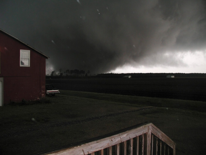 In this April 16, 2011 photo provided by Bonnie Burkett, a tornado moves through Colerain, N.C. The photographer, Richard Burkett, snapped the picture shortly before he and his wife took cover in a closet underneath their stairs. The tornado hit their barn and came over their house seconds after the picture was taken.