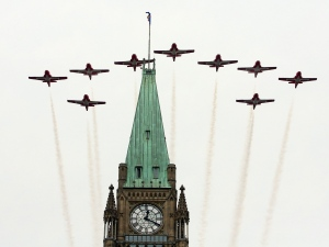 The Snowbirds Canadian aerobatic jets fly over the Peace Tower at the Canada Day celebrations on Parliament Hill, in Ottawa Monday, July, 1, 2013. (Fred Chartrand / THE CANADIAN PRESS)