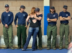 A woman hugs a firefighter before the start of a memorial service in Prescott, Ariz., Monday, July 1, 2013. (AP / Julie Jacobson)