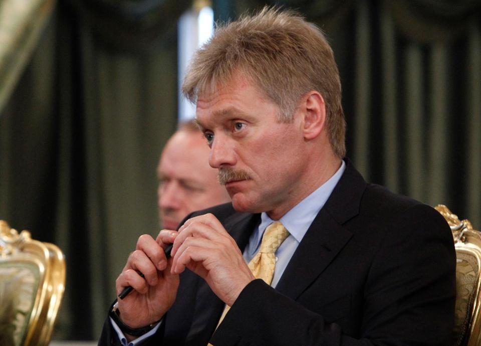 Presidential spokesman Dmitry Peskov listens during a meeting at the Kremlin in Moscow, Tuesday, July 2, 2013. (AP/ Maxim Shemetov)