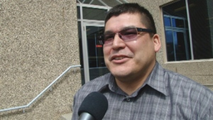 Carry the Kettle First Nation Chief Ivan Thomson speaks to reporters after he was acquitted of assaulting his wife in Regina Provincial Court on Monday.