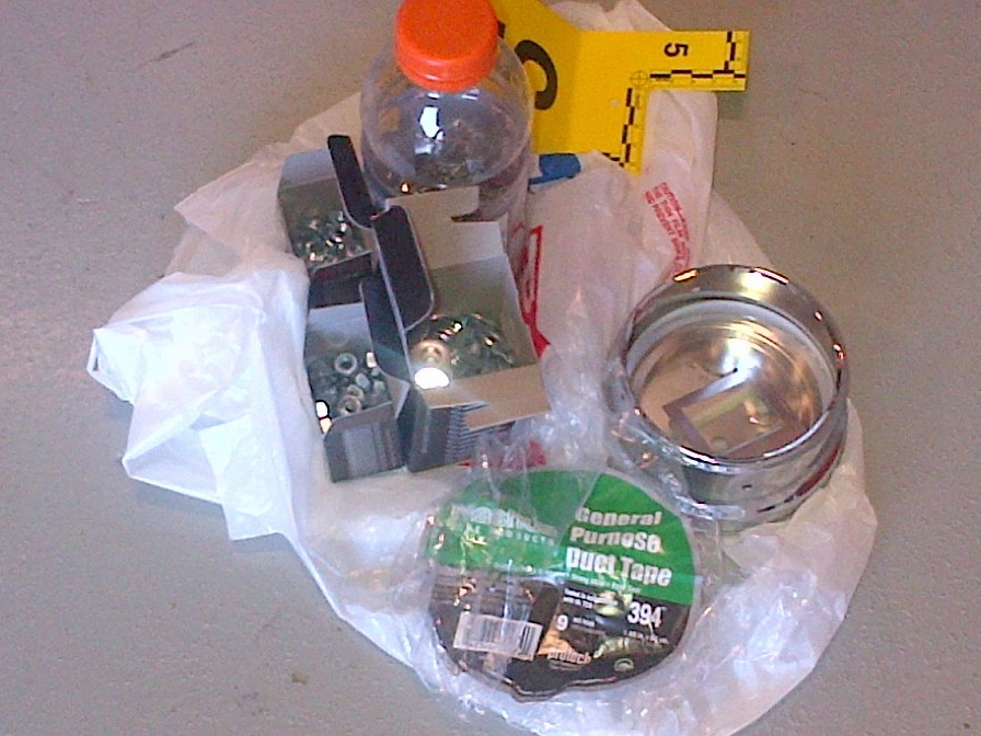 Contents (nuts, bolts, nails and washers) and other materials for the improvised explosive devices (IEDs) are shown in an RCMP handout photo released to media, Tuesday, July 2, 2013.  (RCMP)