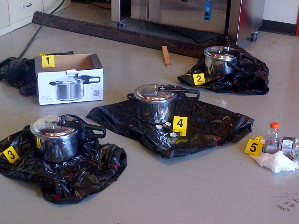 Three pressure cookers to be used as improvised explosive devices (IEDs) are shown in an RCMP handout photo released to media, Tuesday, July 2, 2013. (RCMP)