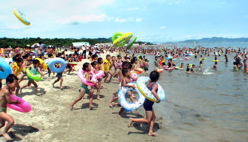 North Korean leader Kim Jong-un plans to transform a port city into a vacation beach resort. (KCNA via KNS)