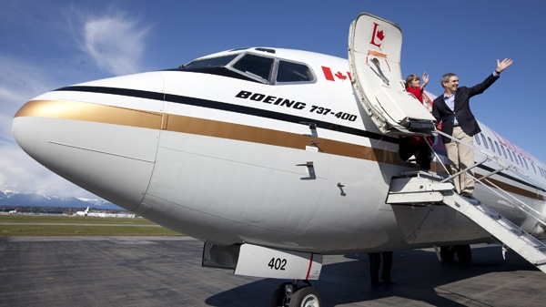 Liberal leader Michael Ignatieff and his wife Zsuzsanna Zsohar board their campaign plane in Vancouver, B.C. Sunday, April 17, 2011. (THE CANADIAN PRESS/Jonathan Hayward)