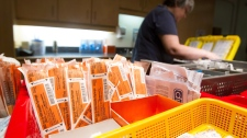 Supplies to be used by drug addicts fill baskets as nurse Arvita Cotter prepares for a shift at the Insite safe injection clinic in Vancouver, B.C., on Monday, April 18, 2011. (Darryl Dyck / THE CANADIAN PRESS)