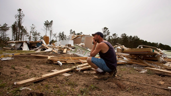 Robert Matalik looks at his home that was destroyed from a tornado Saturday in Deltaville, Va. on Monday, April 18, 2011. (AP / The Virginian-Pilot, Bill Tiernan)