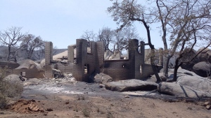 This  photo taken on a tour of the burn area shows the remains of a house destroyed by a wildfire in Yarnell, Ariz., Monday, July 1, 2013. (Arizona House Speaker Andy Tobin)