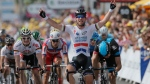 Britain's Marc Cavendish crosses the finish line ahead of Edvald Boasson Hagen of Norway, right and second place, and Andre Greipel of Germany, left and fourth place, to win the fifth stage of the Tour de France cycling race in Marseille, southern France, Wednesday July 3, 2013. (AP / Laurent Rebours)