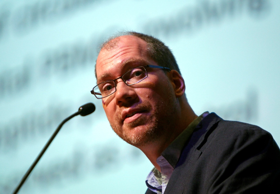 Timothy Henrich of the Harvard-affiliated Brigham and Women's Hospital in Boston speaks at the International AIDS Society Conference 2013 in Kuala Lumpur, Malaysia, Wednesday, July 3, 2013. (AP / Lai Seng Sin)