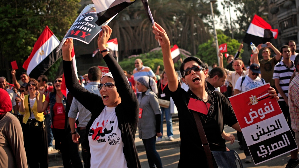 Opponents of Egypt's Islamist President Mohammed Morsi chants slogans during a protest outside the presidential palace, in Cairo, Egypt, Wednesday, July 3, 2013. (AP / Khalil Hamra)