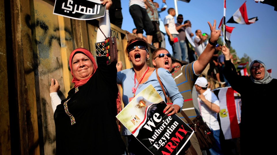 Opponents of Egypt's Islamist President Mohammed Morsi chant slogans during a protest outside the presidential palace, in Cairo, Egypt, Wednesday, July 3, 2013. (AP / Khalil Hamra)