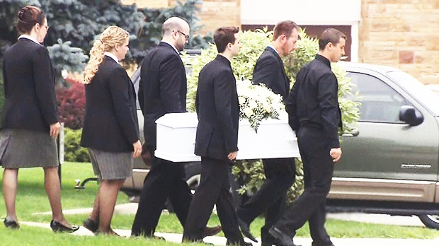 A casket carrying two-year-old Maximus Huyskens is carried into a church for his funeral service, Wednesday, July 3, 2013.