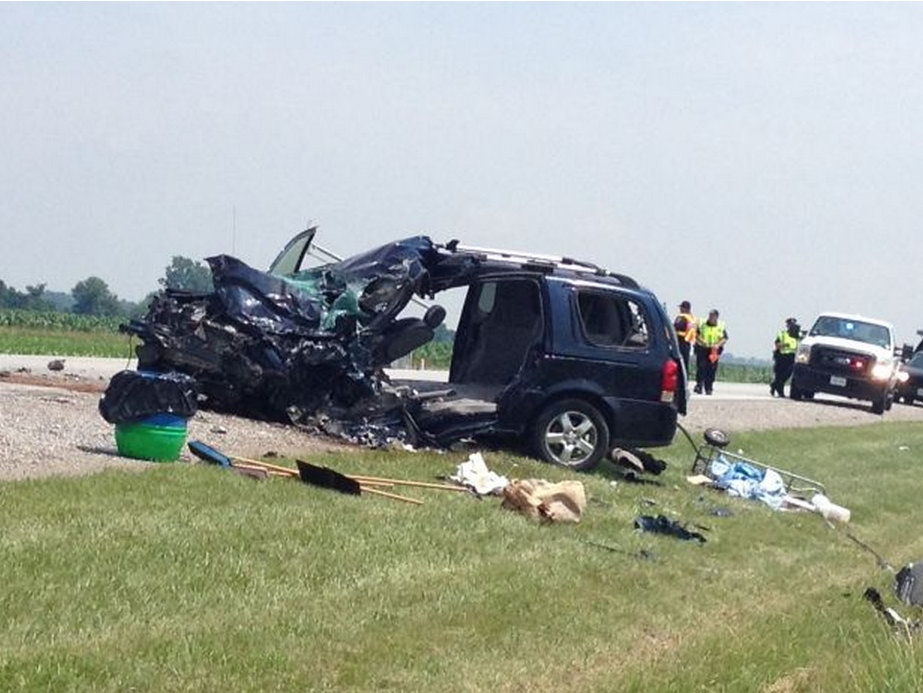 A minivan collided with an ambulance on Queens Line in Chatham, Ont., on Wednesday, July 3, 2013. (Gina Chung / CTV Windsor)