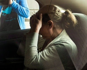 Pamela Porter, wife of Arthur Porter, hides from the cameras in Montreal on June 14, 2013. (Ryan Remiorz / THE CANADIAN PRESS)