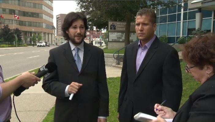 Matthew Waltenberry (right) and lawyer Davin Charney speak to media on Wednesday, July 3, 2013.