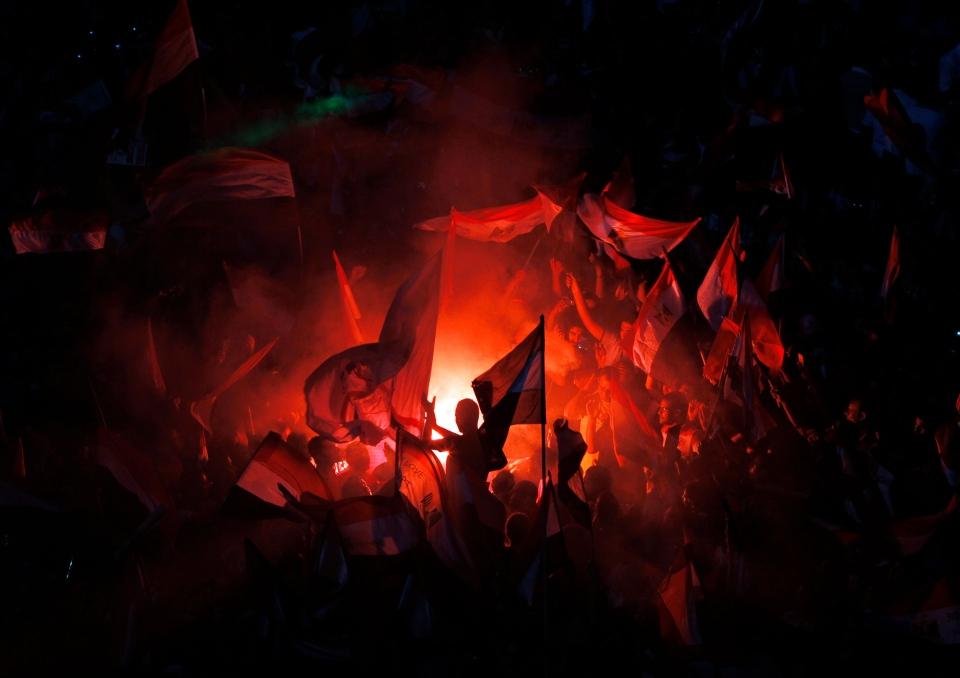 Flares light as opponents of Egypt's Islamist President Mohammed Morsi celebrate in Tahrir Square in Cairo, Egypt, Wednesday, July 3, 2013.  (AP / Amr Nabil)