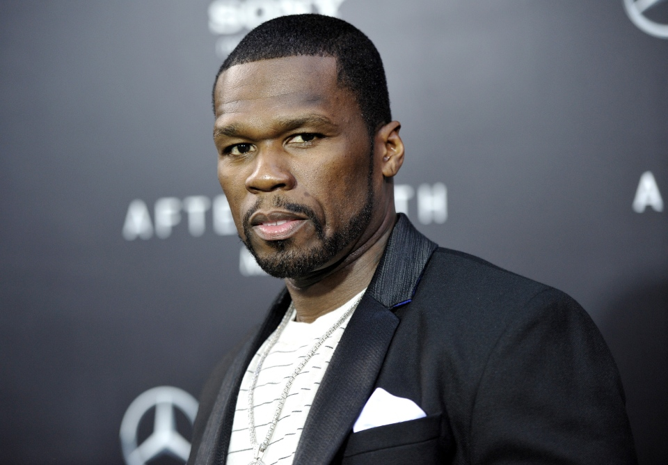 "FILE - In this May 29, 2013, rapper Curtis ""50 Cent"" Jackson attends the ""After Earth"" premiere at the Ziegfeld Theatre, in New York. Jackson has been charged with attacking his ex-girlfriend and trashing her Los Angeles condo last month. City Attorney Mike Feuer said Wednesday, July 3, 2013, the 37-year-old ""In da Club"" singer is charged with domestic violence and vandalism. (Evan Agostini / Invision)"