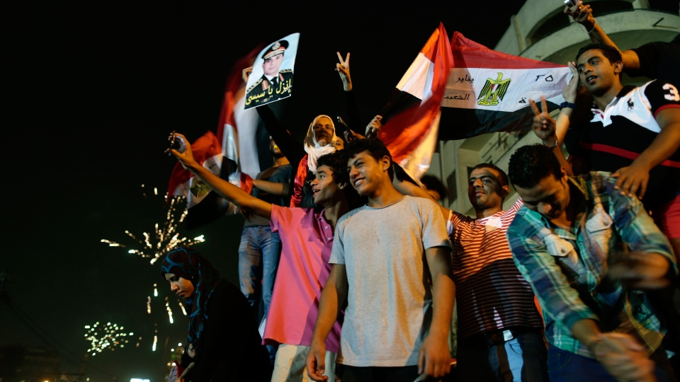 Opponents of Egypt's Islamist leader Mohammed Morsi celebrate outside the presidential palace in Cairo, Egypt, Wednesday, July 3, 2013. (AP / Hassan Ammar)